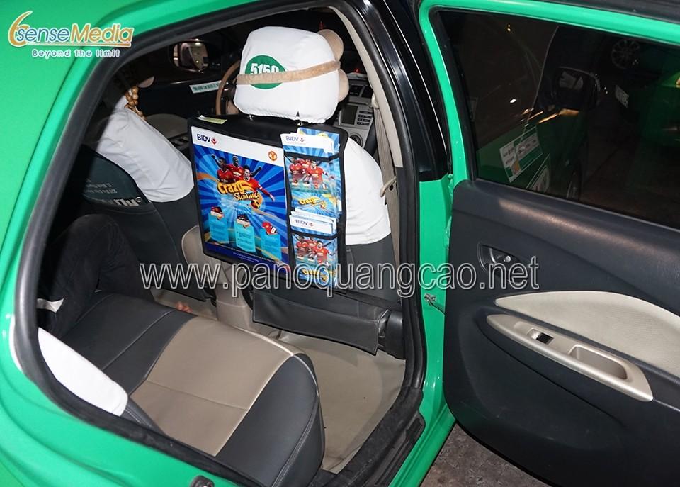 Quảng cáo sau lưng ghế taxi