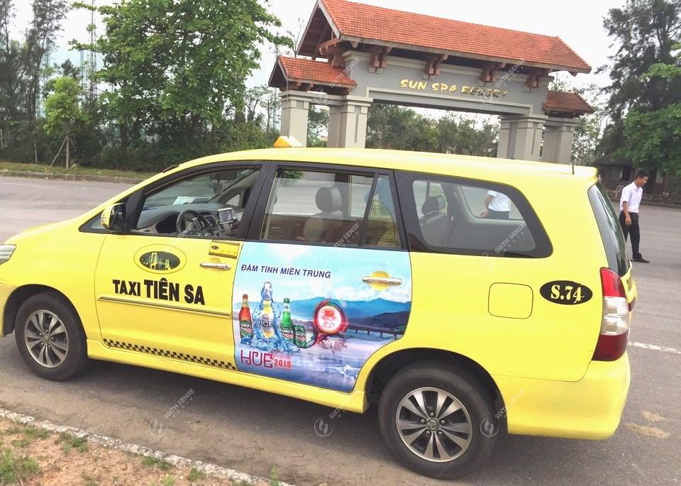 quảng cáo trên xe taxi ở Quảng Bình